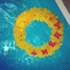 Pink and yellow rubber duck baby shower! Flower wreath with baby's name and rubber duck