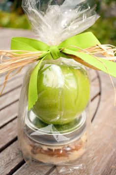 Homemade caramel apple dip in a little mason jar, bagged with a pretty apple and tied with a bow! Fun idea!