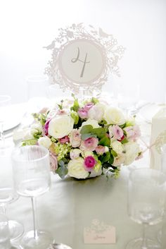 pretty pink centerpiece + intricate table numbers by Cutture, styling by @Andrijana Culjak Benson, photo by Julia Boggio