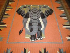The elephant quilt is quilted. Elephant Quilts Pattern, Baby Quilt Patterns, Paper Piecing Patterns, Quilting Ideas, Quilting Designs, African Quilts, Biggest Elephant, Wedding Ring Quilt, Animal Quilts