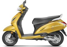 Talking about Honda Activa Colors, newly launched scooter gets 2 new colors: Dazzle yellow metallic and Pearl Spartan Red. Along with Activa Colors. Honda Scooters, Honda Bikes, Honda Motorcycles, Green Motorcycle, Enfield Classic, The New Classic, Green Pictures, Bike News, Yamaha Motor
