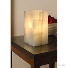 $80.00 Light glows softly through the mottled grain of this dense onyx accent lamp.