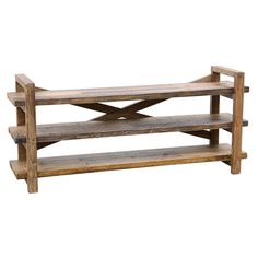 Artfully crafted from reclaimed wood, this 3-shelf media console adds a rustic touch to your living room or master suite.  Product: ...