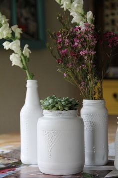 Glass jars with puffy paint, then spray paint! #DIY #Crafty