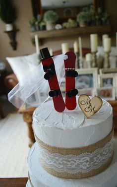 """This wedding topper is perfect for the couple that loves snowboarding!!! Made of resin,this snowboarding couple come fully decorated ready to represent you on your big day! This topper is truly unique and sure to have your guests commenting.They look so beautiful in pictures,and make a really cute keepsake after the big day.Just remove the sticks,add a jute tie to each snowboard,and your wedding topper can become a Christmas ornament. The topper is shown on a """" cake tier. Please message…"""