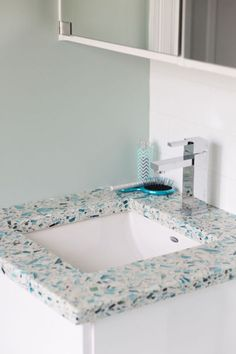 Recycled glass vanity countertops are one of 8 cool glass products featured for a contemporary bathroom in this article. The post 7 ½ Crystal-Cool Ways to Use Glass in a Contemporary Bathroom appeared first on Dekoration. Beach House Bathroom, Glass Bathroom, Bathroom Wall Decor, Small Bathroom, Glass Vanity, Bathroom Ideas, Bathroom Towels, Coastal Bathrooms, Beach Bathrooms