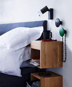 wall mounted bedside table? maybe hack up the one that's in the office & screw it to the wall?