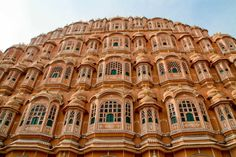 """Hawa Mahal  Hawa Mahal is also called as 'Palace of Wind' or 'Palace of Breeze'. Its unique five-story has 953 small windows called jharokhas decorated with intricate lattice work is a fine piece of Rajput architecture, built in 1799, by Maharaja Sawai Pratap Singh, and is the most recognizable monument of Jaipur. The display """"Jaipur past and present"""" is the special feature of this newly setup museum."""