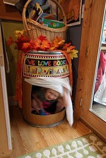 OMG - what a great idea for a 'cozy area' a hollowed out rain barrel nook!!!!