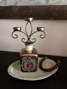 A personal favorite from my Etsy shop https://www.etsy.com/listing/514457846/distressed-don-juan-tequila-candelabra