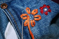 Upcycled Embroidered Jeans: Embroidered Jeans are the new rage this summer. They are almost everywhere, which inspired me to make my own diy version! Hand Embroidery Flowers, Embroidery On Clothes, Embroidered Flowers, Embroidery Stitches, Diy Jean Embroidery, How To Make Clothes, Diy Clothes, Fashion Fabric, Denim Fashion