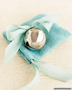 A wedding bell favor is a darling idea for your guests to ring for you to kiss your groom during the reception or to send you two off on your honeymoon. | At least one per table