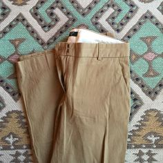 J.CREW khaki pants 4S city fit khaki pants. Small hole in back of pants, can cover with a belt! J. Crew Pants Trousers