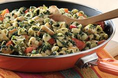 Bite-size pieces of chicken breasts and pasta shells team up to give this cheesy, spinachy skillet dish its hearty appeal.