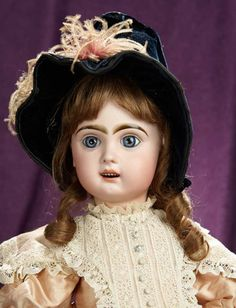 """23"""" French bisque Bebe Jumeau, size 11, with beautiful paperweight eyes~~23"""" (58 cm.) Bisque socket head, blue glass paperweight inset eyes, lushly painted facial features, open mouth, outlined lips, row of porcelain teeth, pierced ears, brunette human hair, French composition and wooden fully-jointed body, wearing pretty rose silk tussah dress in the French style, bonnet, undergarments, antique does. Marks: 11. Emile Jumeau, circa 1895."""