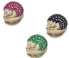 Ruby, sapphire, emerald, and diamond hedgehog brooches by Jean Pierre Brun.