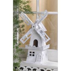 ' Windmill Birdhouse' is going up for auction at  2am Fri, May 18 with a starting bid of $1.Tophatter