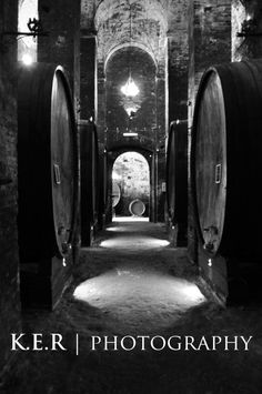 Barrels of wine in the deep and ancient cellar of the Cantina di Redi - Montepulciano, Italy