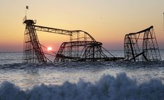 Jet Star Roller-coaster, Seaside Heights, New Jersey. The Jet Star Roller-coaster was left submerged in the Atlantic Ocean after Superstorm Sandy in 2013. It bravely fought the waves for six months, before being salvaged. Photo via Indicepr.