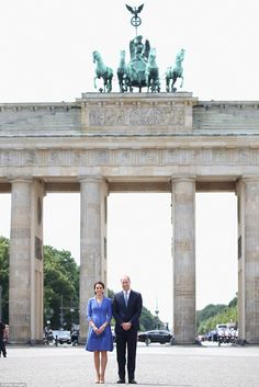 The couple pose in front of the most recognisable symbol of Germany, both as a divided nation in the bleak days of the Cold War and as one of the powerhouses of Europe in its post-1990 reunified state
