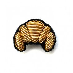 """SMALL HAND-EMBROIDERED """"CROISSANT"""" PIN"""