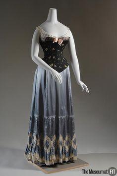 1903, America - Petticoat - Blue silk satin and cream lace & 1900-1905, America - Corset - Black cotton sateen, pink satin, and black lace