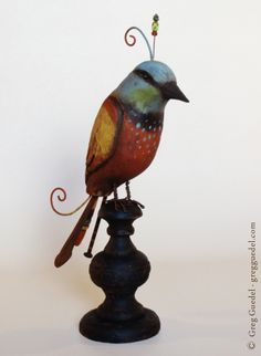 Folk art, hand carved bird by Greg Guedel.  www.gregguedel.com