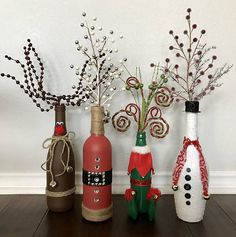 ***I am now taking pre-orders...please allow 1-2 weeks for shipping.*** $15 is for ONE vase: Santa, Rudolph, Elf, or Snowman bottle vases with decorative picks. Set of 3 includes: Santa, Rudolph, and Snowman. Set of 4 includes: Santa, Rudolph, Snowman, and Elf. Disclaimer: Bottle