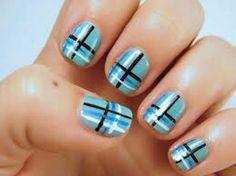 Blue, black, and white plaid nail design