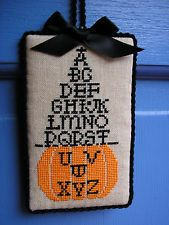 finished completed Curtis Boehringer Pumpkin Witch Hat cross stitch ornament