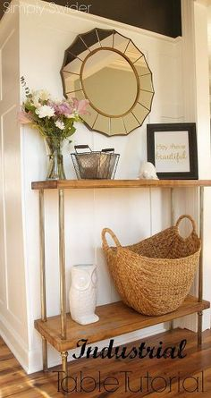 We added a gold sunburst mirror, some art, and baskets to finish off the space and give the table a more refined look.