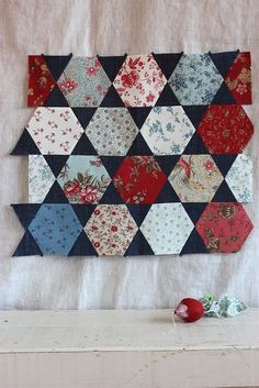 Hex N More Ruler from Jaybird Quilts; I like the dark color used for the triangle background pieces