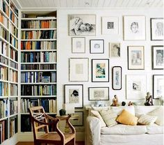 A cozy room. Reminds me of my bedroom growing up with the gallery wall.