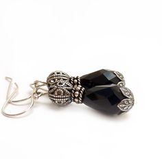 Hey, I found this really awesome Etsy listing at http://www.etsy.com/listing/119415552/black-teardrop-earrings-antiqued-silver