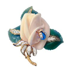 David Webb.18 kt. gold gold flower clip in whittle coral, jade & turquoise, with diamonds accents. Signed. Circa 1950s