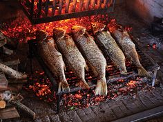 Fish stuffed with loads of herbs and rubbed with a simple garlic butter are grilled whole, which leaves them with a smoky, charred flavor and tender meat. Whole Sea Bass Recipes, Grilled Sea Bass Recipes, Grilling Tips, Grilling Recipes, Seafood Recipes, Oven Recipes, Tilapia Recipes, Camping Recipes, Easy Recipes