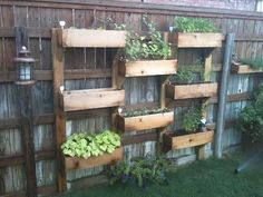 cedar planter boxes for a wooden fence