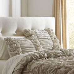 Laurel Comforter Set, Stone | Made of 100% cotton voile, this comforter set features hand-turned knots and ruched details. Set includes two shams.
