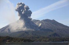 February 24, 2013 - Eruption of Sakurajima volcano producing ash cloud over Sakurajima island (Blue) with sea in foreground, Kagoshima, Japan Poster Print (34 x 22)