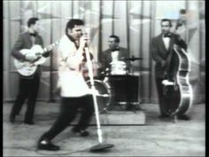 """""""Elvis Presley - Hound Dog (1956"""")- This video is one of the first performances of Elvis Presley's song Hound Dog. Elvis and his Rock and Roll style music for white people in the fifties sparked a huge change in culture for young people. Elvis sparked much controversy for his provocative hip shaking and new style, leading the way for what was to be a generation of 'rebels.'"""