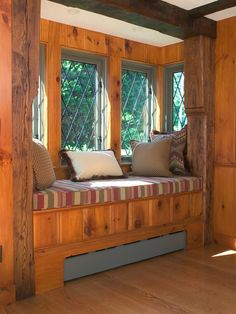 I love the way this window seating is tucked in to a space that would otherwise be unused.  Small cabins (around 1000 sq. feet need to utilize every inch.