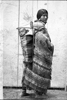 Yakama woman with baby in cradleboard on her back