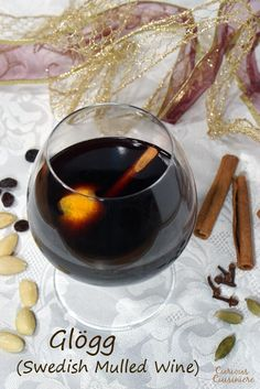 This recipe for Swedish Glögg creates the perfectly spiced, warming drink for serving at holiday party or just relaxing and enjoying the season. | www.curiouscuisiniere.com