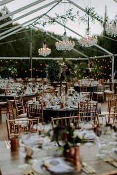 Glass wedding reception tent with chandeliers and beautiful lighting, Click pic to see more of this Enchanted Garden Wedding in Modern, Romantic Jewel Tones.   #gardenwedding #redwedding #jeweltonedwedding #burgundywedding #outdoorwedding #weddingideas #weddingdecor #confettidaydreams #fairytalewedding #romanticwedding