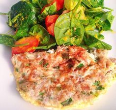 Tuna fish omelette with onions and a spinach and tomato salad.