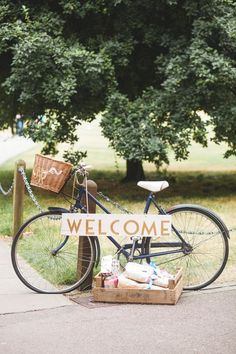 old fashioned vintage bicycle as a prop at your wedding with welcoming signage / http://www.himisspuff.com/bicycle-wedding-ideas/6/