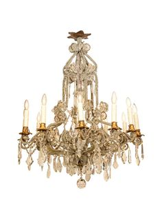 Its six scrolling candlearms split into doubles, holding twelve lights, the entire fixture strung with crystal swags and decorated by hand-cut prisms and pendulums, finished with a faceted ball drop. || TheHighBoy || #highboystyle #antiquesmakeitbetter #antiques #vintage #homedecoration #chandeliers