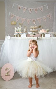 Child's Cinderella themed birthday party with lots of glittery gold and powder pink