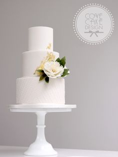 White fondant wedding cake with frilly sugar peony royal icing beading and abstract gold leaf