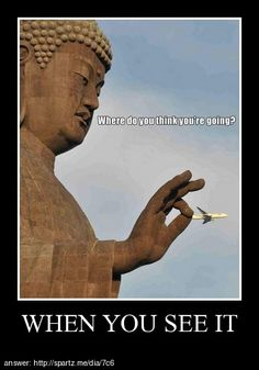 The statue isn't holding the plane, the plane is just farther away which makes the illusion